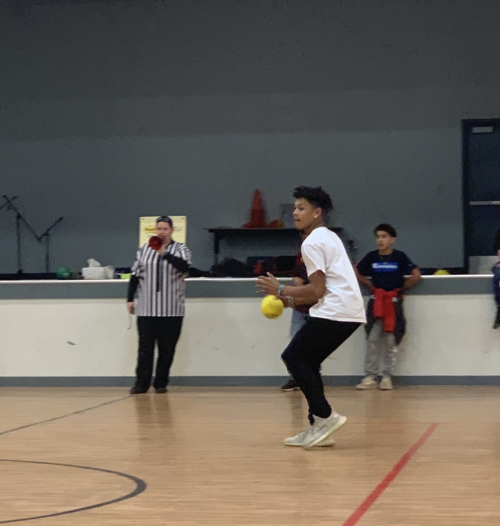 8th grade boy playing dodgeball